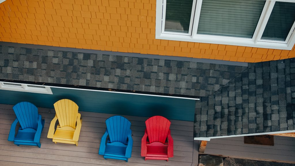 porch with muskoka chairs